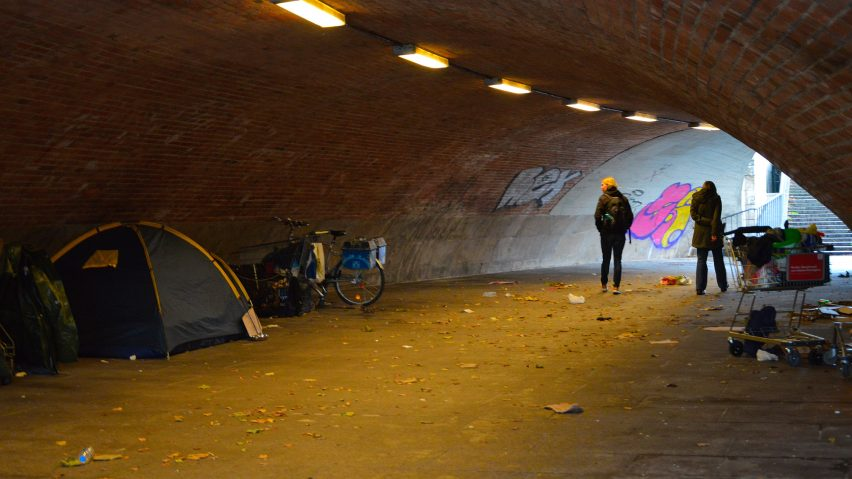 Homeless people camp in an underpass in Berlin