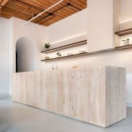 StudioAC links Candy Loft interiors with arched hallways in Toronto