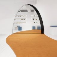 Bower Studios' arched mirror alludes to doorway in Gray Matters shoe showroom
