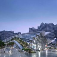 Arching rooftop walkway and garden tops West Kowloon Station in Hong Kong