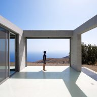En Route Architects perches linear concrete house on Greek island hillside