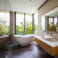Bathroom in Stepping Park House by Vo Trong Nghia in Ho Chi Minh City, Vietnam