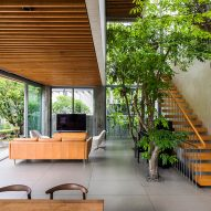 Living room in Stepping Park House by Vo Trong Nghia in Ho Chi Minh City, Vietnam