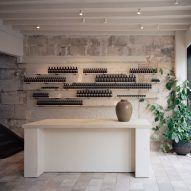 Local architecture informs stone interiors of Aesop store in Bath