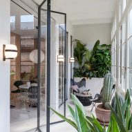 YLAB Arquitectos creates holiday apartment with indoor garden and hidden kitchen