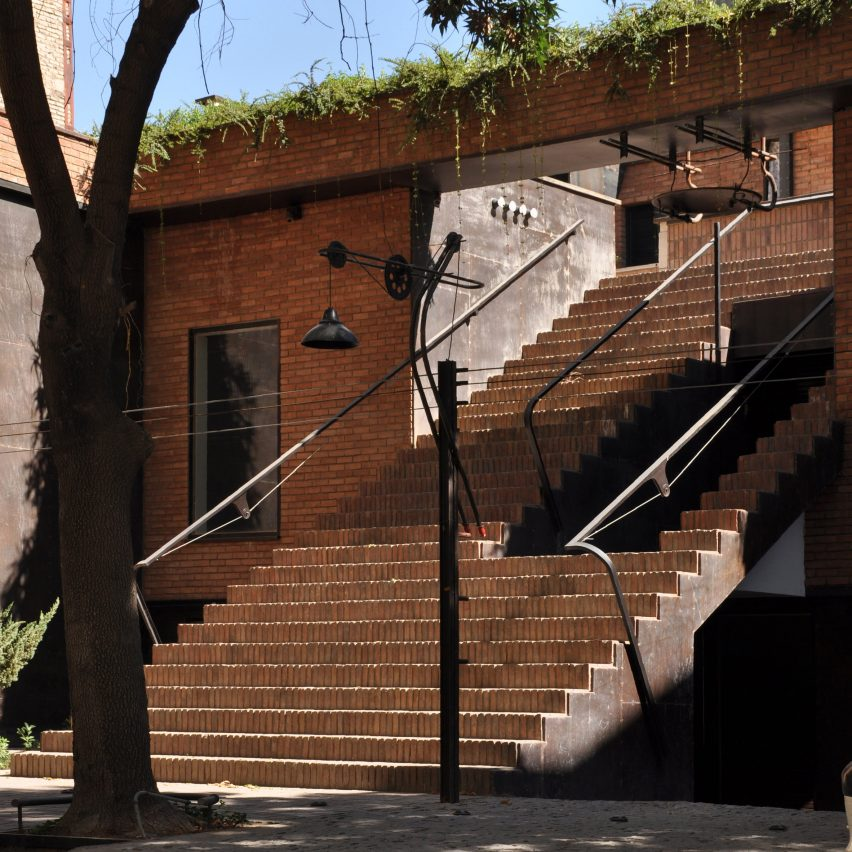 Showroom in Mashhad creates public spaces with brick staircase and rooftop terrace
