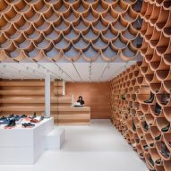 Terracotta tiles create shelves in Kengo Kuma-designed Camper store in Barcelona