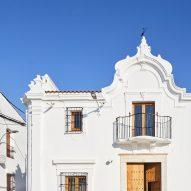 Front facade of Casa Villalba de los Barros, designed by Lucas y Hernández-Gil