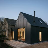 Eastabrook Architects adds corrugated metal extension to Cotswolds cottage