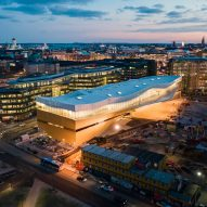 "Helsinki Central Library Oodi topped with translucent ""book heaven"""
