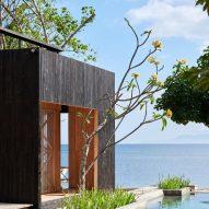 Atelier Riri creates charred teak cabins at Kiyakabin resort in Indonesia