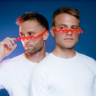"Bentel Brothers design red glasses as ""squiggle for your face"""