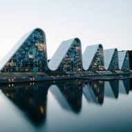 Henning Larsen completes The Wave housing with rollercoaster-like roofs in Denmark