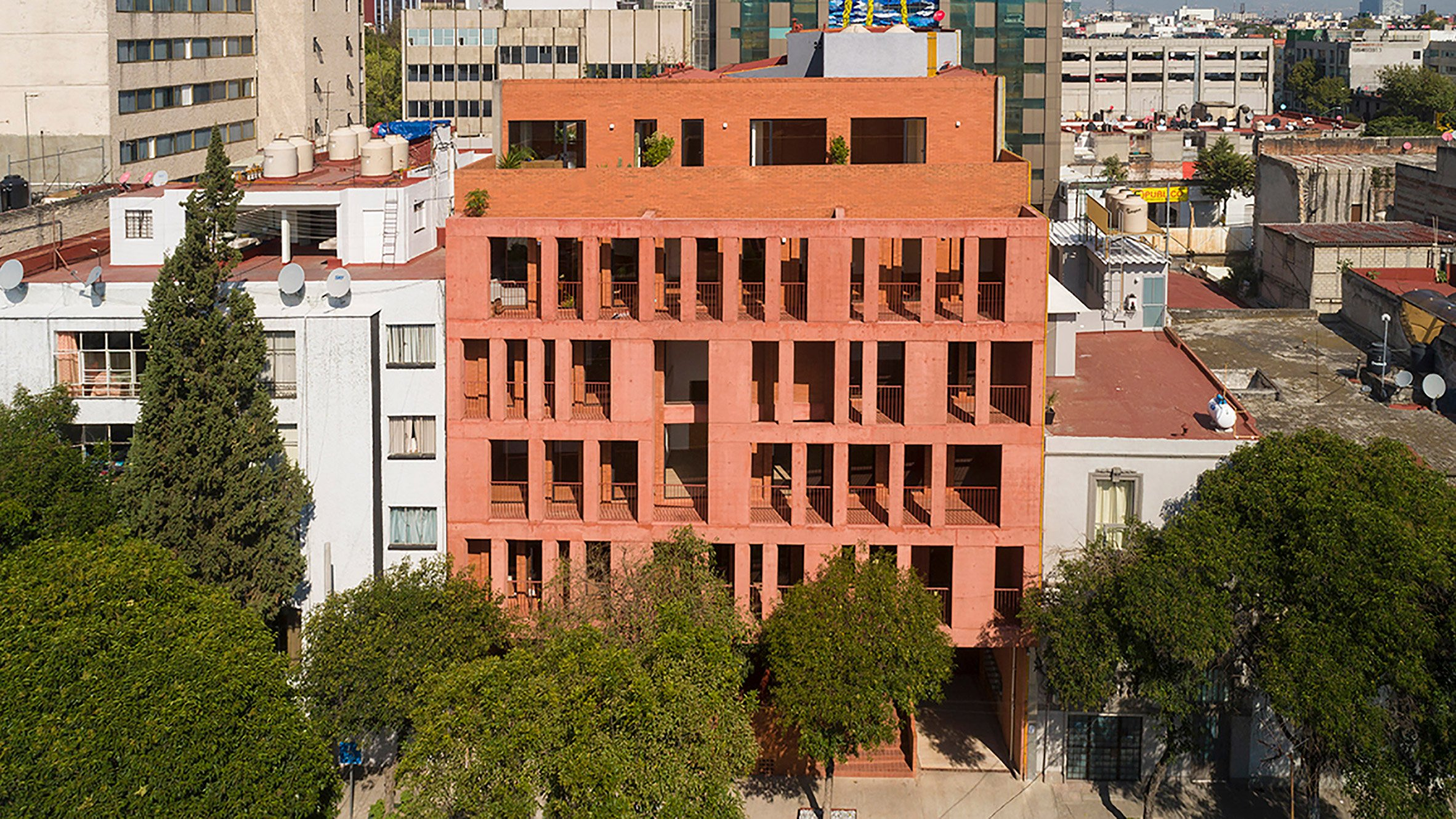Red brick and concrete form CPDA's 139 Schultz apartments in Mexico City
