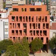 Red brick and tinted concrete form CPDA's 139 Schultz apartment block in Mexico City