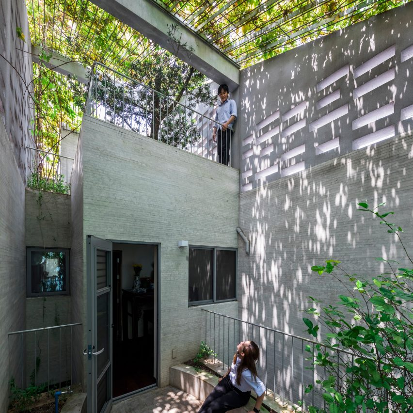 Plant curtain drapes over Breathing House by Vo Trong Nghia Architects