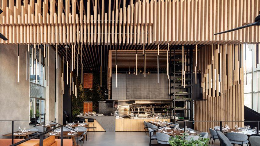 Timber screens divide up Tel Aviv restaurant L28 by Kimmel Eshkolot Architects