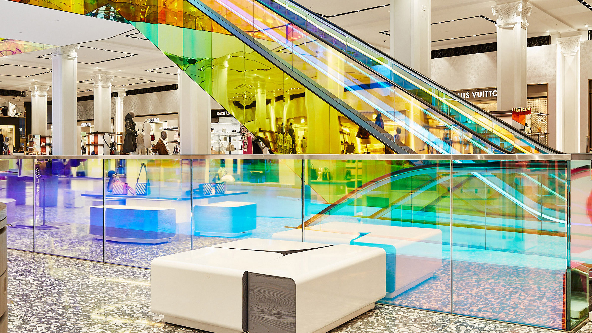 1200db54c823 OMA adds iridescent glass escalator to New York's Saks Fifth Avenue