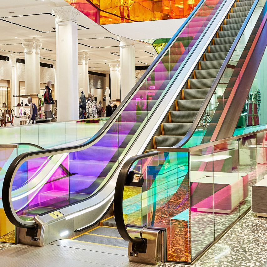 OMA adds iridescent glass escalator to New York's Saks Fifth Avenue