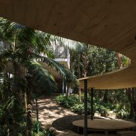 Curved pavilion nestles among gardens at Lina Bo Bardi's Glass House in São Paulo