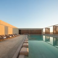 Al Faya Lodge by Anarchitect is a desert spa and hotel made from stone and steel