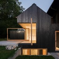 Buero Wagner uses charred timber to clad lake house extension in Germany