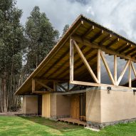 Angled roof tops rammed-earth walls of Rama Estudio's Casa Lasso in rural Ecuador