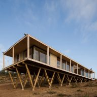 Dock House in coastal Chile by SAA rests on triangular wooden stilts
