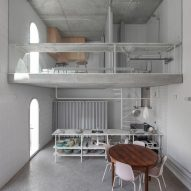 Staggered floors overlook four-storey void at architect's house in Lisbon