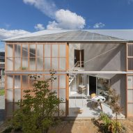Huge sliding door reveals courtyard at House in Sonobe by Tato Architects