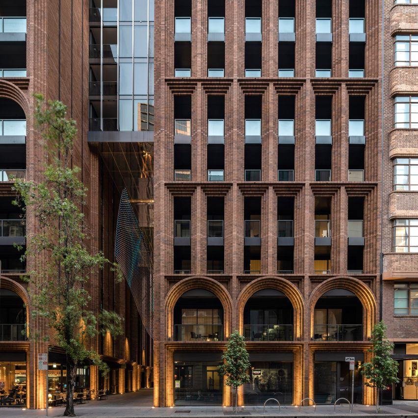 Brick archways topped by rounded glass tower at Arc by Koichi Takada Architects