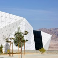 Faceted aluminium panelling wraps Ramon Airport in Israeli desert