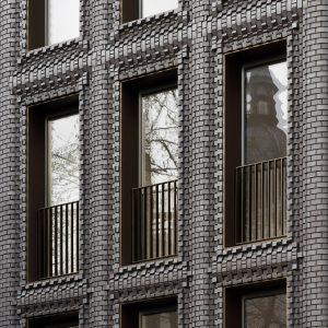 Bureau De Change Inserts Textured Black Brick Building Into London Terrace