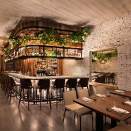 Rockwell Group fills New York's Wayan restaurant with wood and lush greenery