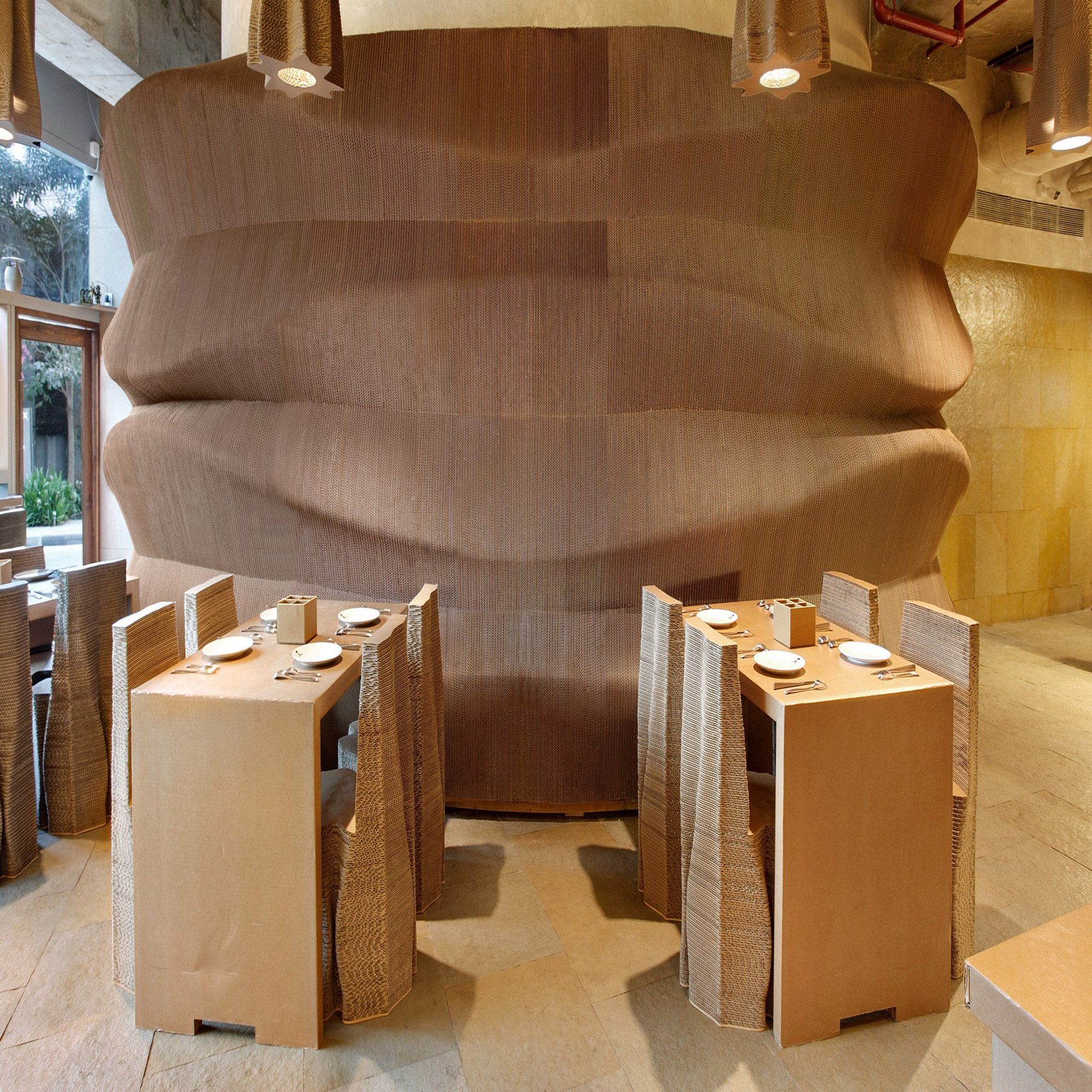 Cardboard cafe by Nudes in Mumbai is made entirely from recycled cardboard