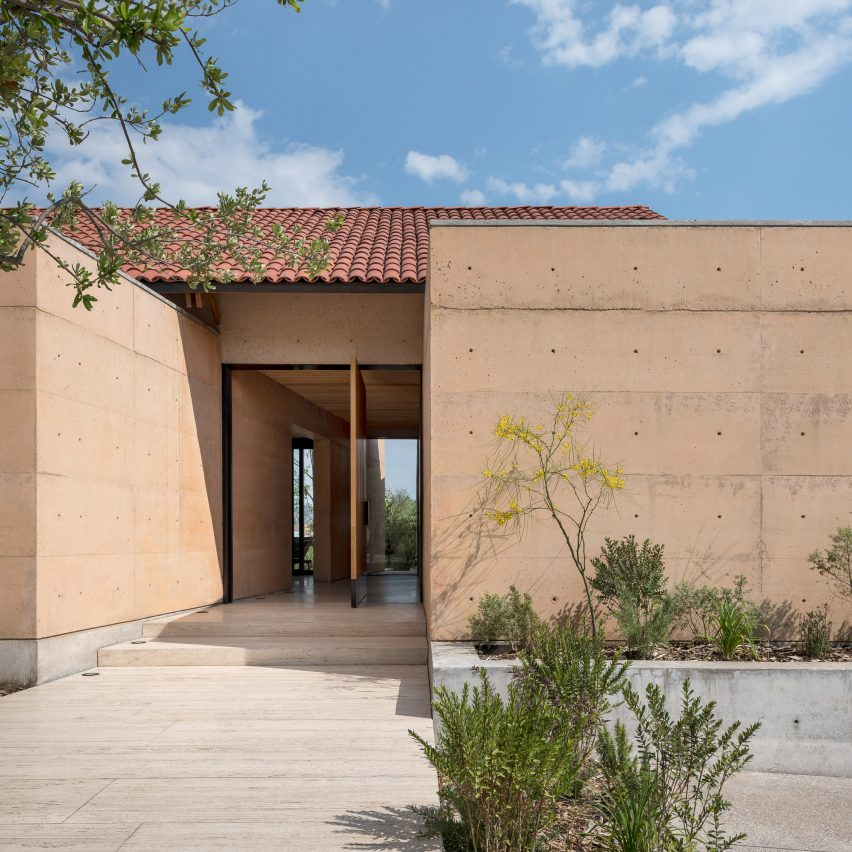 """Concrete walls tinted to match """"warm tones of sunset"""" form Casa Moulat in Mexico"""