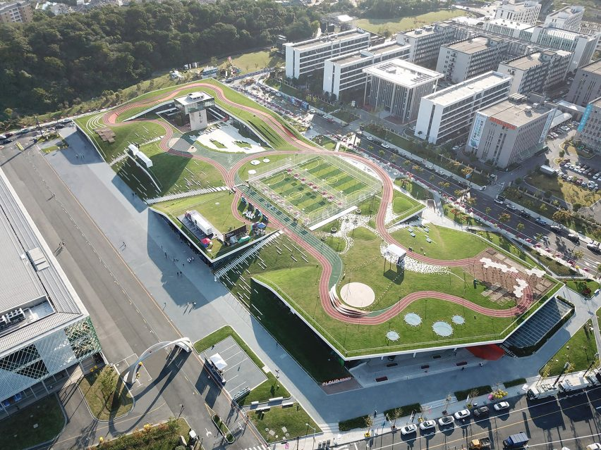 Hangzhou Cloud Town Exhibition Center by Approach Design has a green roof with a running track