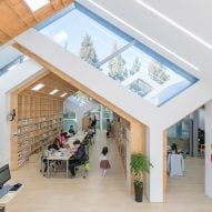 Colliding gabled structures form Hannae Forest of Wisdom community centre