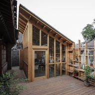 Zai's Hutong Filter features a pixelated shingle wall overlooking a traditional courtyard