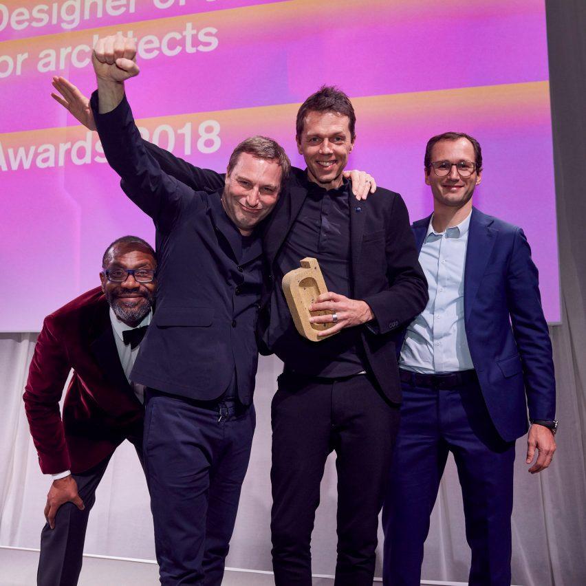 Jaspar Jansen and Jeroen Dellensen picking up their trophy for interior designer of the year at the Dezeen Awards 2018 ceremony, enter the studio categories now