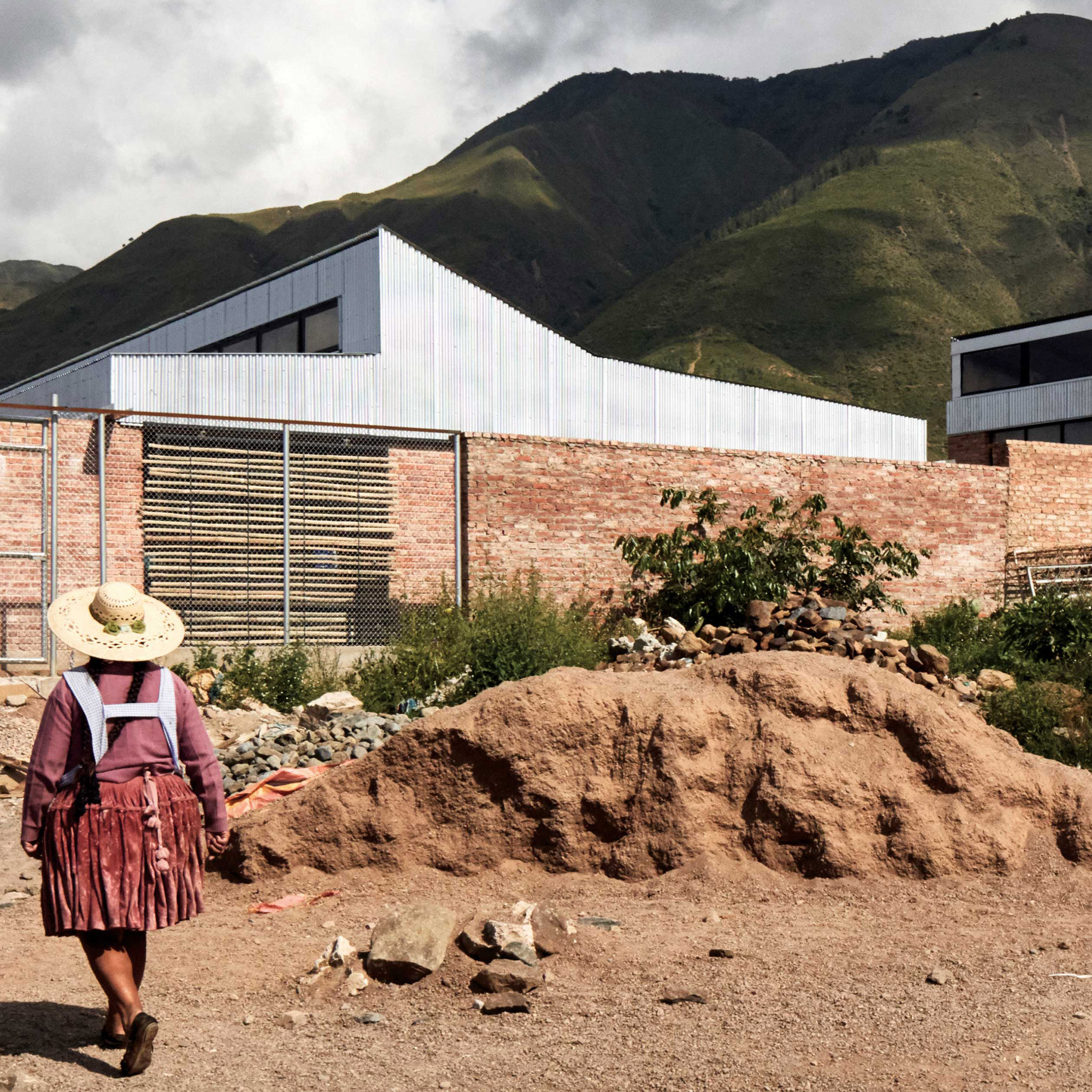 Ralf Pasel and students use handmade bricks for boarding house at Bolivia school