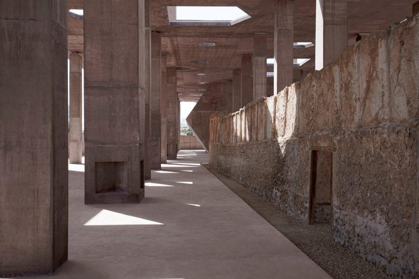 Valerio Olgiati creates red concrete canopy for Pearling Path in Bahrain