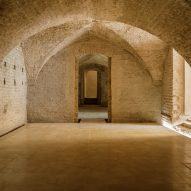 Reina & Asociados creates exhibition space within vaulted cellars of Seville's Alcázar