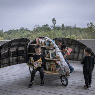 LUO Studio designs a children's microlibrary from recycled abandoned bicycles