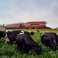 "Bosske Architecture encloses robotic dairy in red ""super shed"" in Australia"