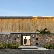 Bamboo screen fronts minimal home on Mexico's west coast by Zozaya Arquitectos
