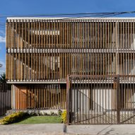 Wooden shutters shade Edificio Criba apartments in Ecuador by Rama Estudio