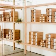 Jordana Maisie stacks cardboard shoe boxes around Feit's San Francisco store