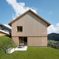Shutters are concealed in the walls of Austrian farmhouse extension by Firm Architekten