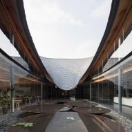 Archi-Union references calligraphy in curving tiled roof of Inkstone House cultural centre